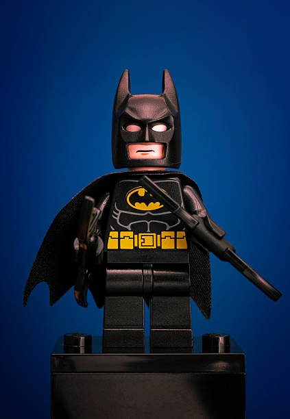 Lego Batman minifigure on blue background stock photo