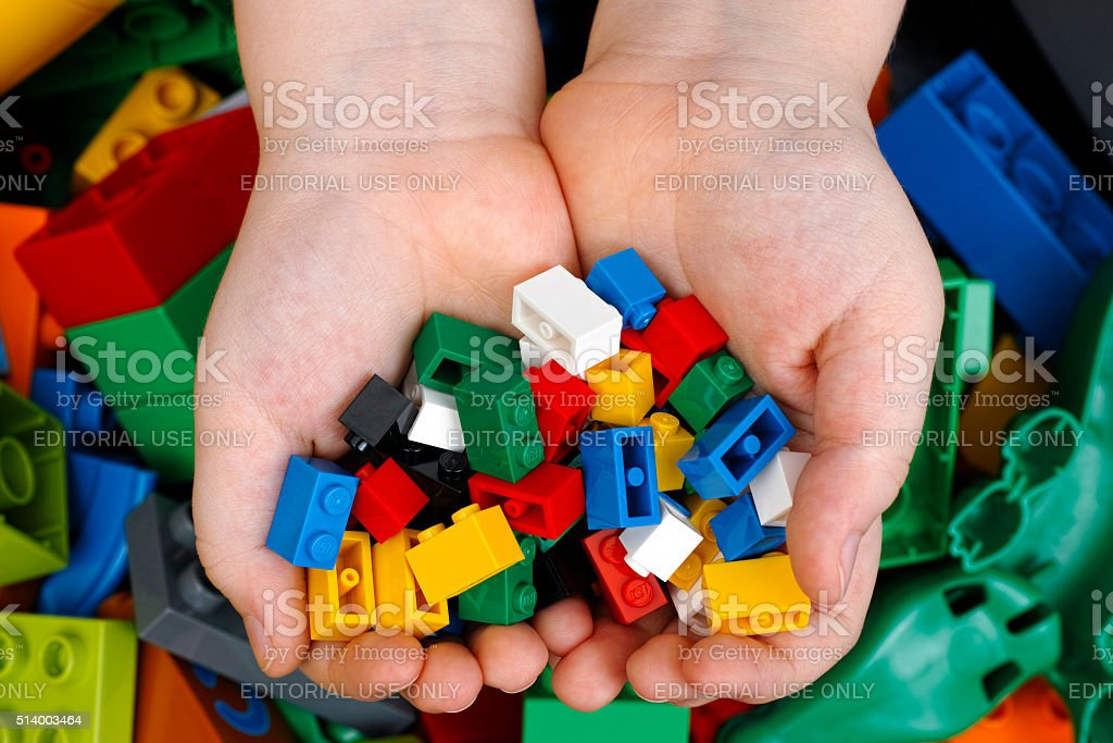 Lego Bricks in child hands stock photo
