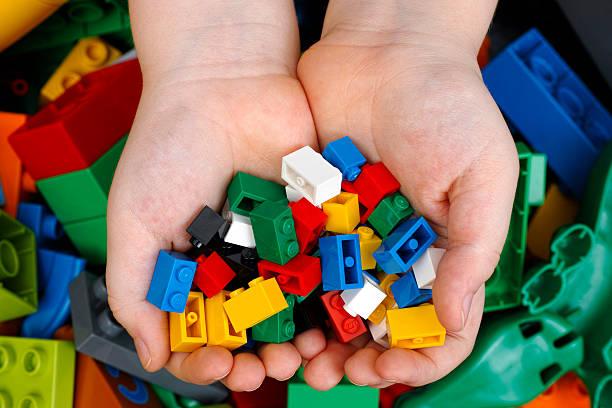 lego bricks in child hands - lego stockfoto's en -beelden