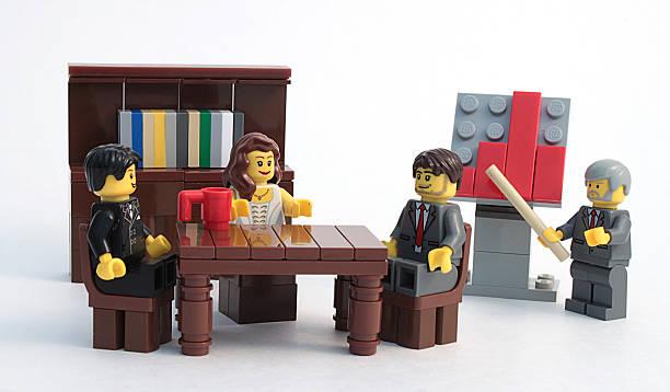 lego business meeting with chart - lego stockfoto's en -beelden
