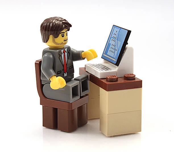 lego businessman at his computer - lego stockfoto's en -beelden