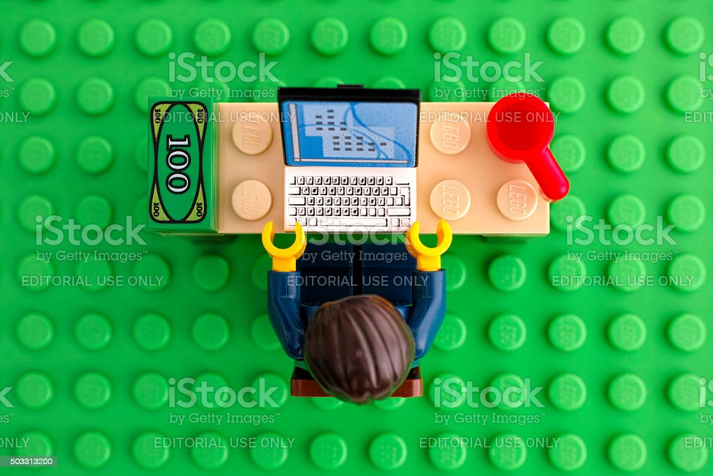 Lego businessman at his working place stock photo