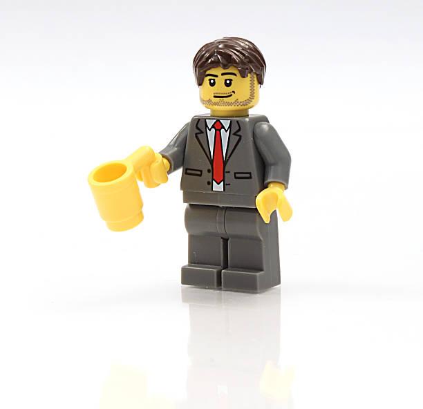 Lego Businessman holding mug stock photo