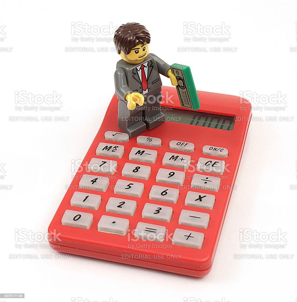 Lego Businessman on Calculator stock photo