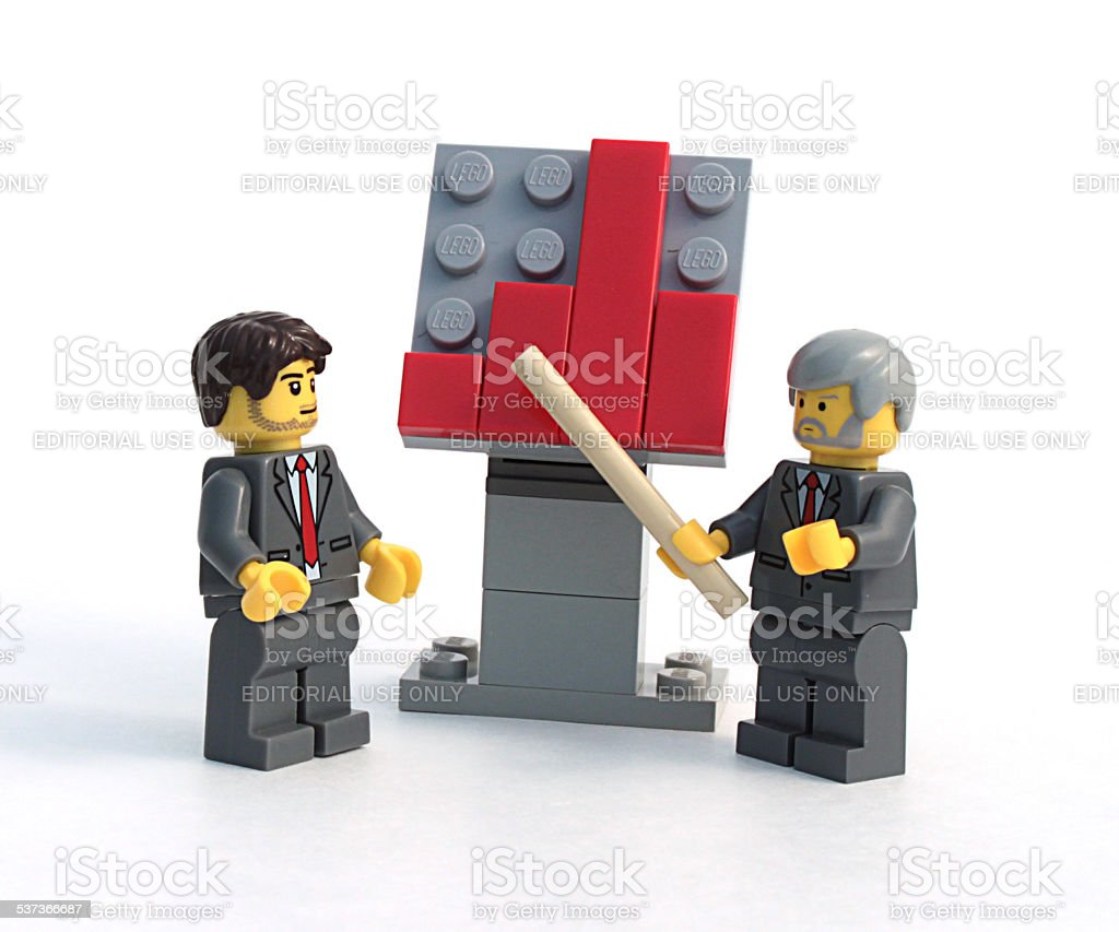 Lego Businessmen Discussing Charg stock photo