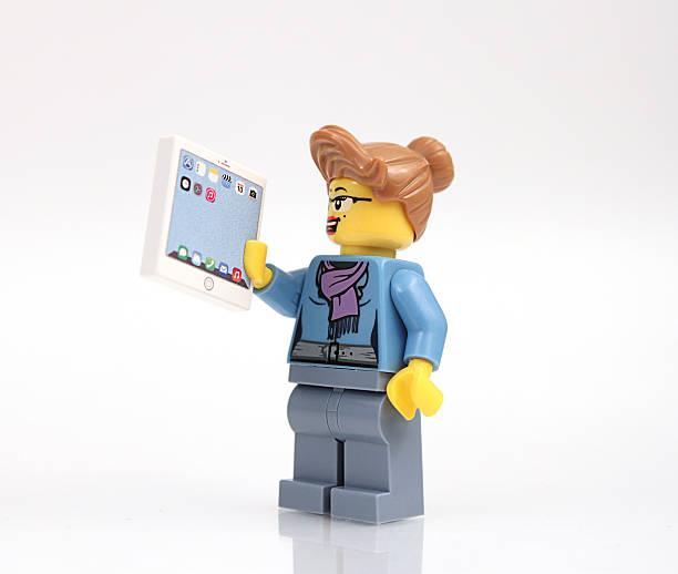 lego businesswoman with tablet - lego stockfoto's en -beelden