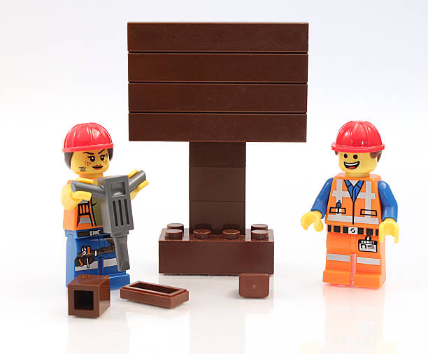Lego Construction Workers with Sign stock photo