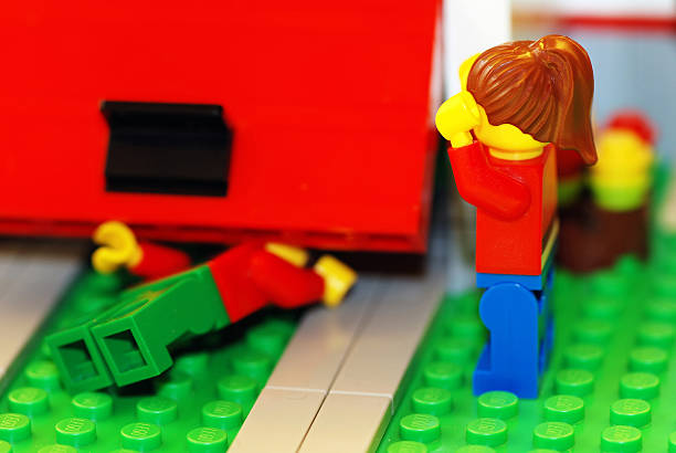 lego couple garage accident - lego house stock photos and pictures