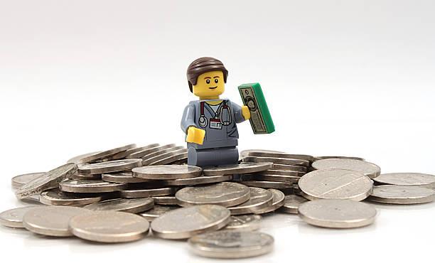 Lego Doctor on money stock photo