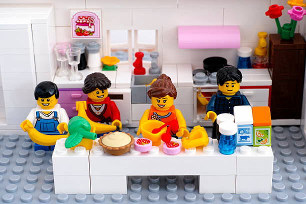 lego family in domestic kitchen - lego house stock photos and pictures
