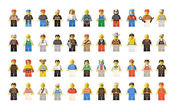 lego figures men and women - figurine stock photos and pictures