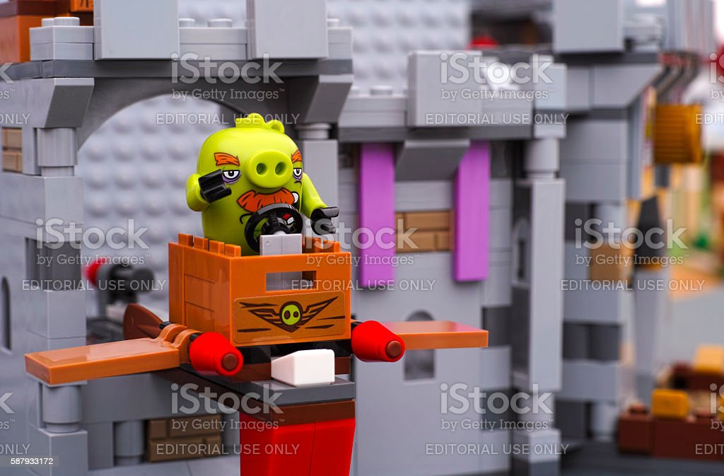 Lego Foreman Pig sitting in TNT box with wings. stock photo