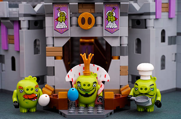 Lego King Pig, Chef Pig and Foreman Pig near Castle entrance stock photo