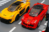 Tambov, Russian Federation - March 05, 2015: Lego LaFerrari and Lego McLaren P1 cars by LEGO Speed Champions with drivers minifigures inside going to start race. Studio shot.