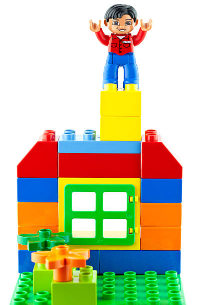 lego man and house - lego house stock photos and pictures