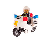 Warsaw, Poland - January 12, 2012: Studio shot - isolated on white. Lego toy company in Denmark. Figure of a policeman on a motorcycle.