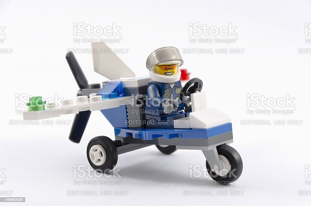 Lego policeman figure with aircraft stock photo