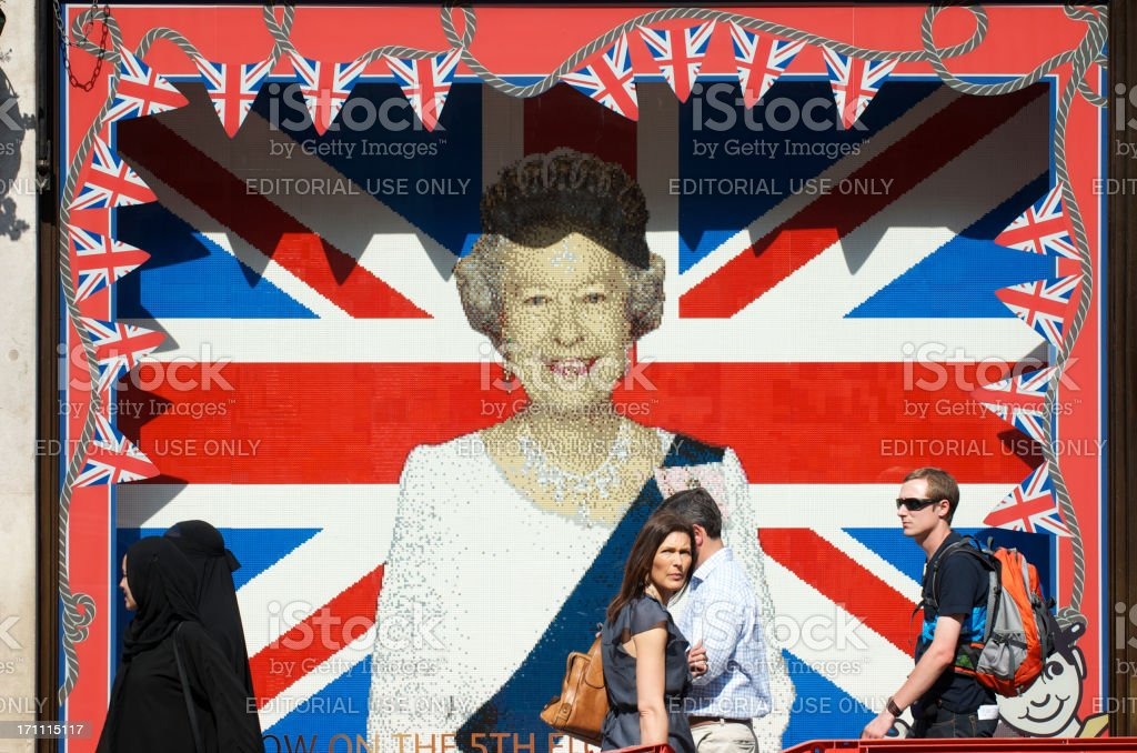 Lego Portrait of the Queen London with Pedestrians Passing stock photo