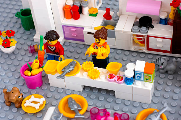 lego scene. cooking dinner on domestic kitchen. - lego house stock photos and pictures