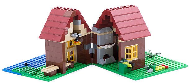 lego split house - lego house stock photos and pictures