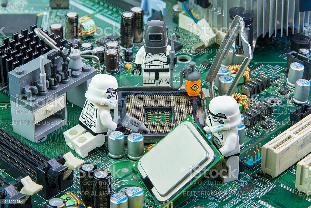 Lego star wars repairing computer motherboard stock photo