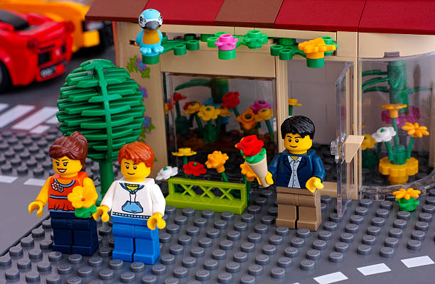 lego street with flowers shop - lego house stock photos and pictures