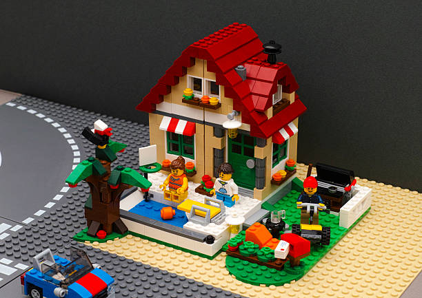 lego summer house with pool and backyard - lego house stock photos and pictures