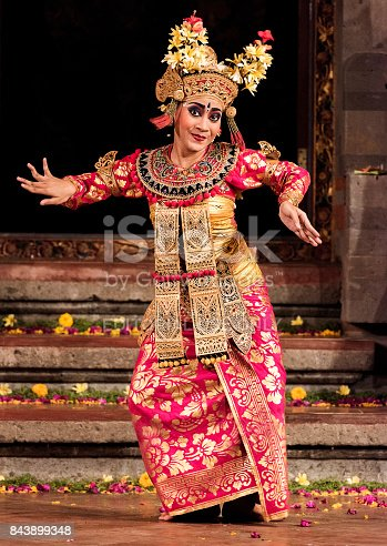 Bali, Indonesia - October 2015: Balinese dancers wearing traditional costume and performing traditional Legong Dance in a small theatre in Bali, Indonesia