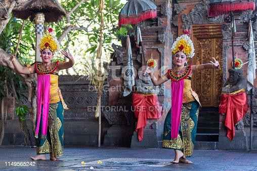 Denpasar, Indonesia - March 28, 2019: Legong dancers performance during Barong Dance, Balinese traditional dancing.