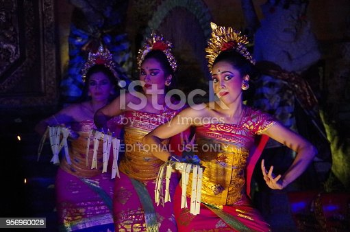 Ubud, Bali, Indonesia - April 30, 2018: Traditional performer of Legong culture dances at Ubud Palace. Legong dance is made up of traditional stories. The sound of a mysterious gamelan is flowing around.