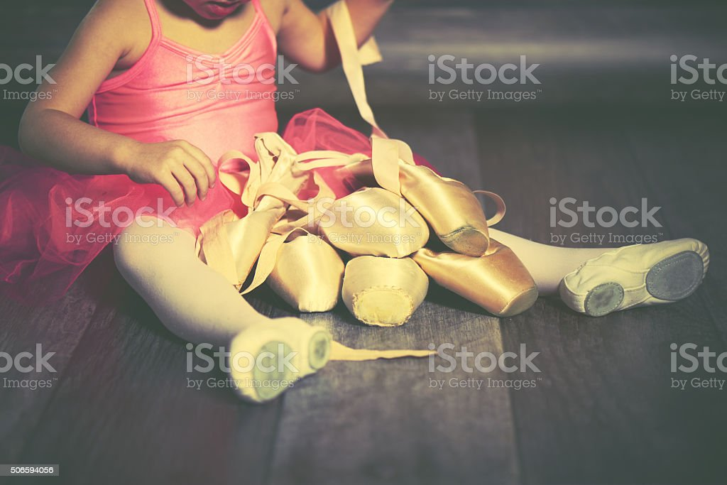 legs a little ballerina with ballet pointe shoes stock photo