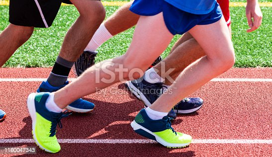 986840244istockphoto Legs and feet on a red track 1160047343