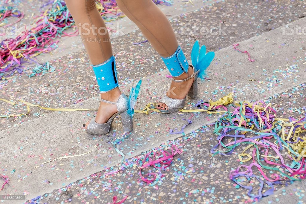 Legs and shoes girls at the carnival. stock photo