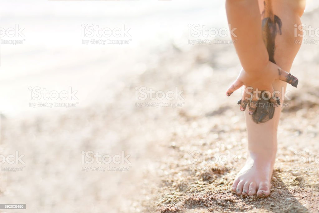 Legs covered with black health mud, closeup. stock photo