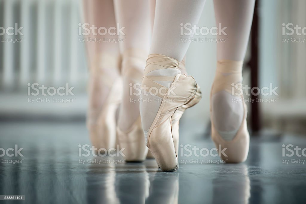 Legs dancers on white pointe stock photo