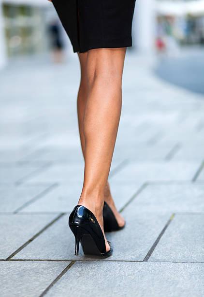legs in black heel shoes - druck strumpfhosen stock-fotos und bilder