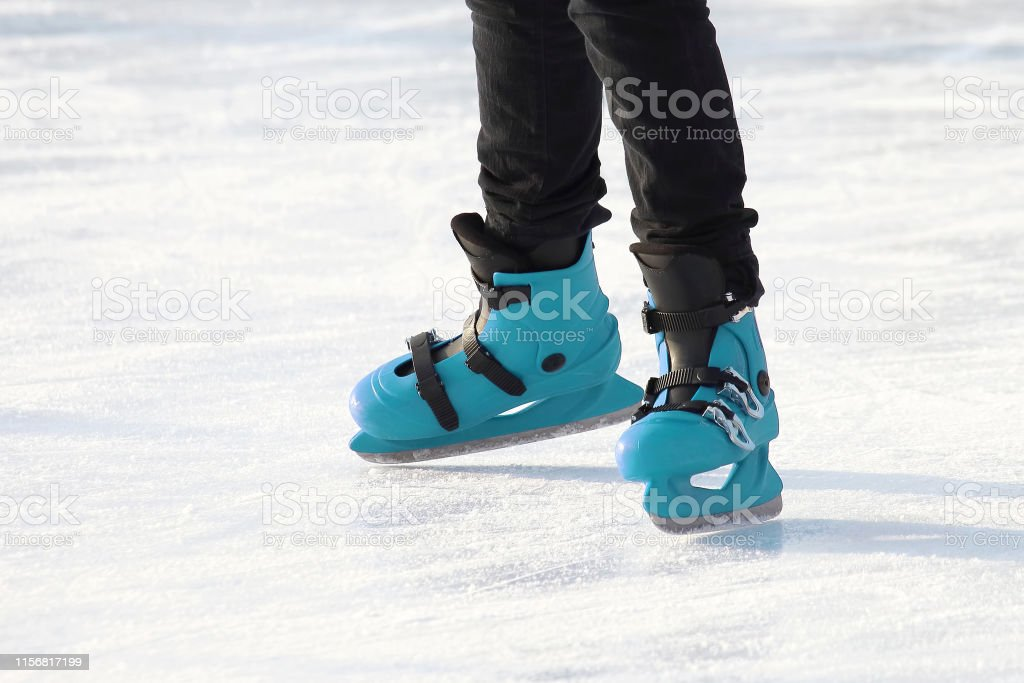 legs in blue skating on the ice rink. sports, Hobbies and recreation...