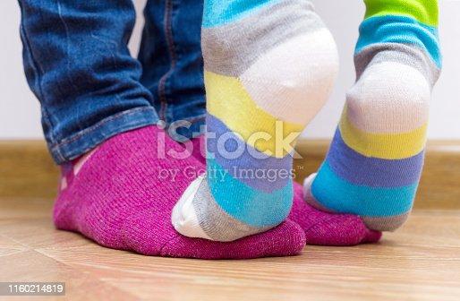 istock Legs in bright socks. Part of body, selective focus. 1160214819