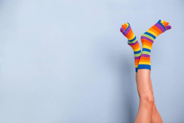 Legs in funny socks stock photo