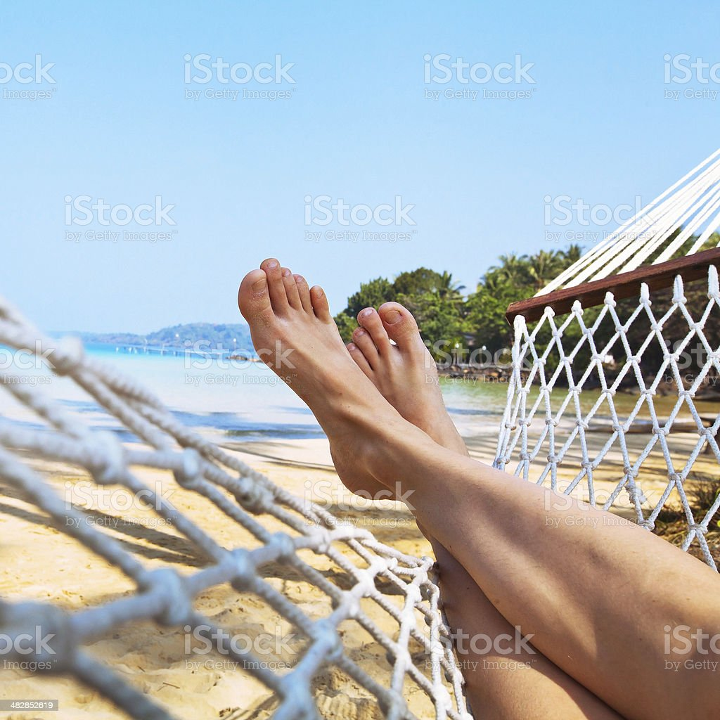 legs in hammock stock photo