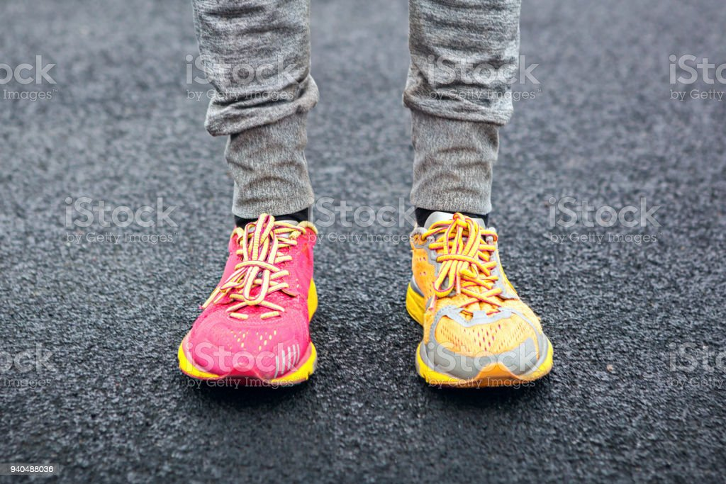 Legs in multi-colored running shoes. stock photo