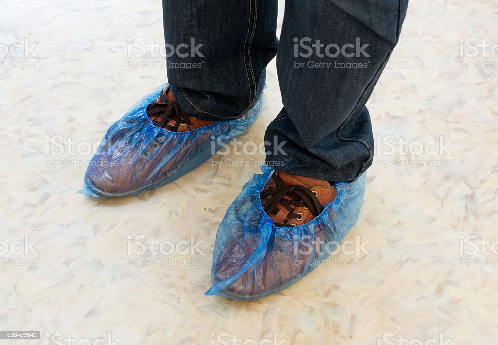 Legs in Shoe Covers stock photo