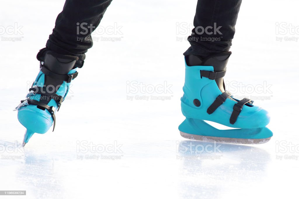 legs in skating on the ice rink. sports, Hobbies and recreation of...