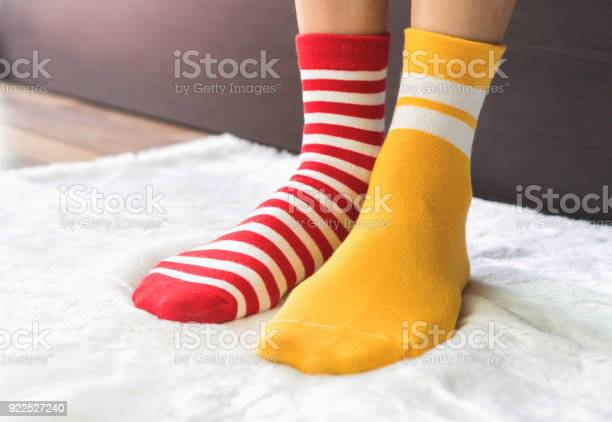 Legs in socks two colors alternate red and yellow side stand on white picture id922527240?b=1&k=6&m=922527240&s=612x612&h=dc1ypv hy mguvc klevfrzw8c7zoh6wrbd en1rkge=