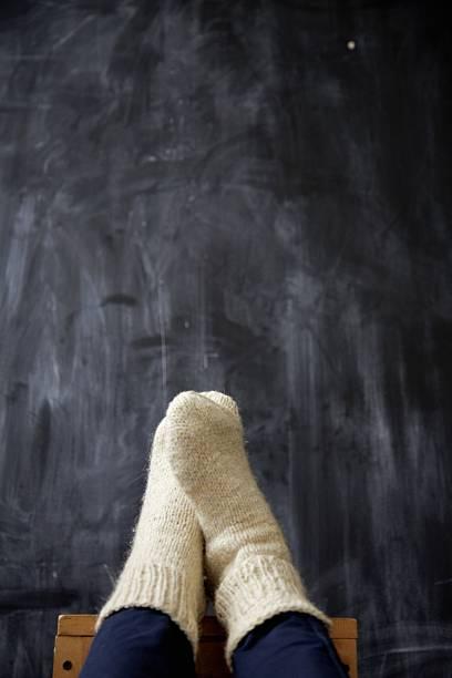 legs in warm knitted sockes – Foto