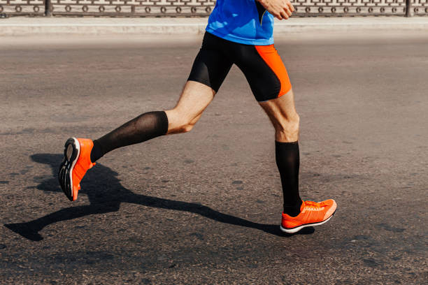 legs male runner in compression socks stock photo