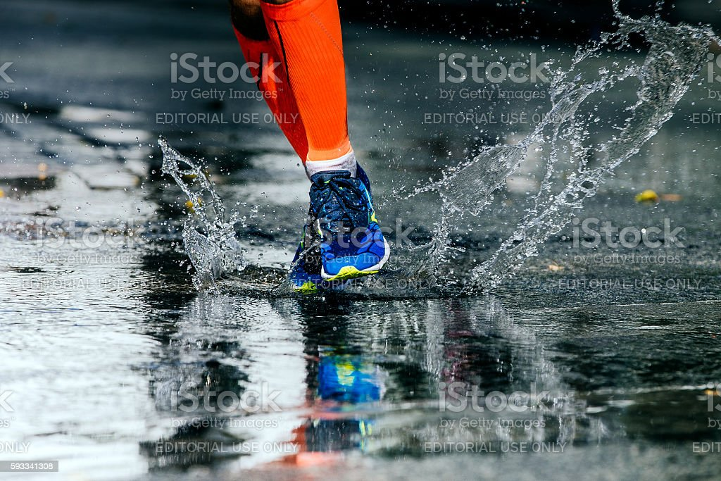 legs men in marathon compression socks stock photo