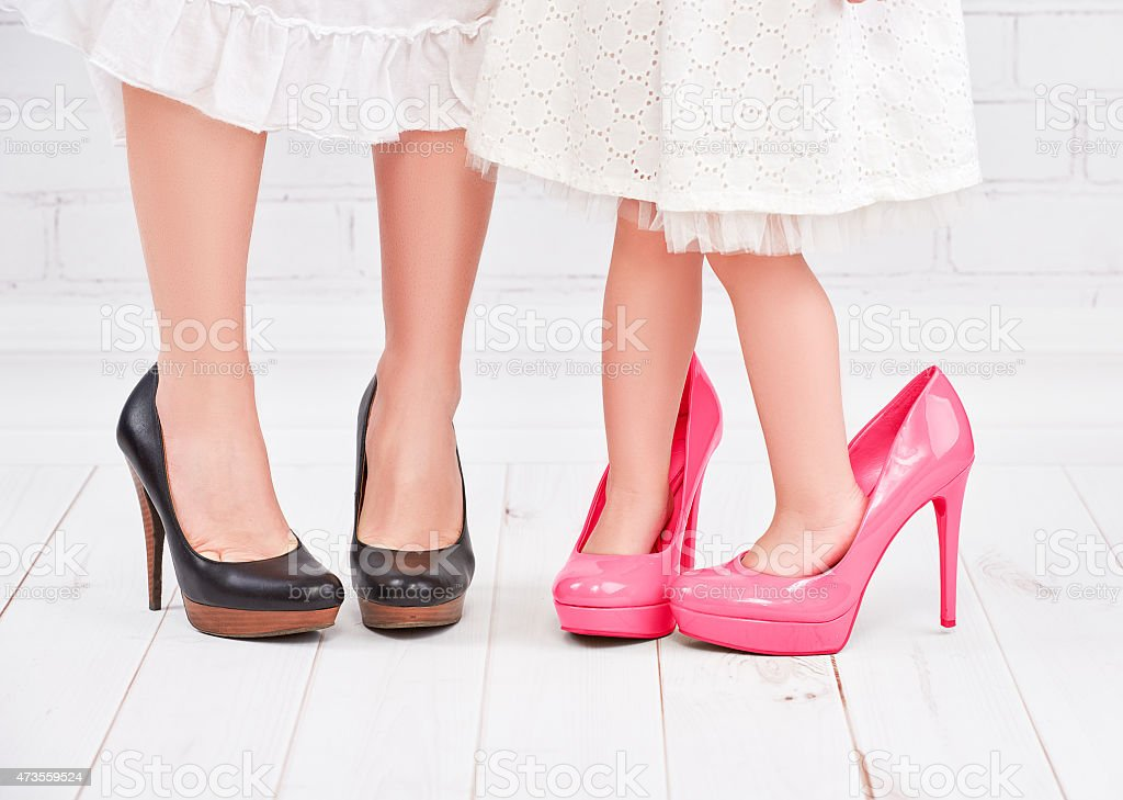 legs mother and daughter little girl fashionista in pink shoes stock photo