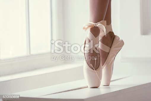 istock Legs of a ballerina in pointe 520593658