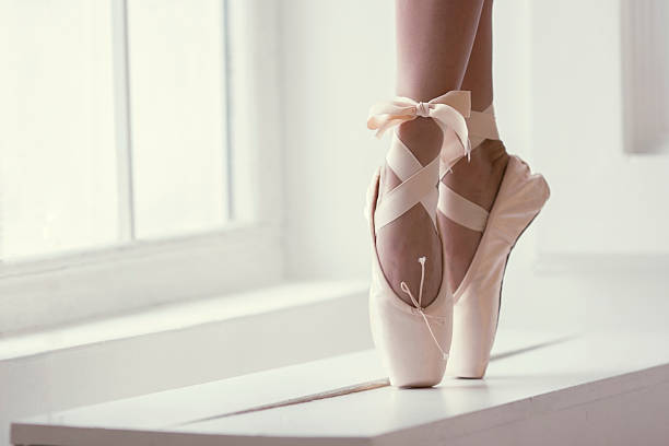 Legs of a ballerina in pointe stock photo